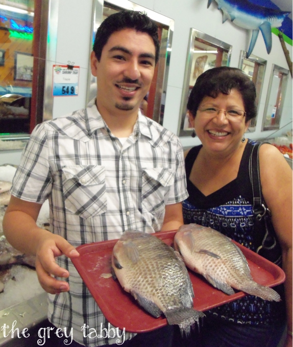 Jose & his mom picking out our fishy lunch